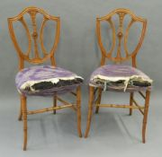 A pair of Victorian satinwood shield back bedroom chairs