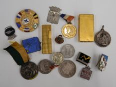 A quantity of miscellaneous items, including medallions, lighters, etc.
