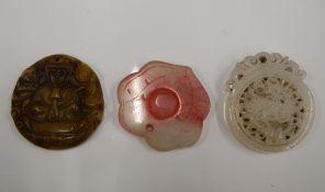 Three carved jade roundels