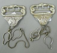 A pair of Chinese unmarked white metal suspenders