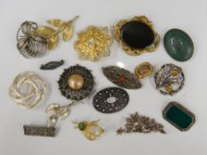 A collection of various brooches