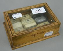 A box containing various Royal Stationery Office watercolour blocks
