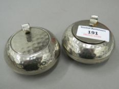 A pair of curling stone form salts