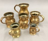 Six graduated brass and bronze pub measures (1/4 gill, half gill,