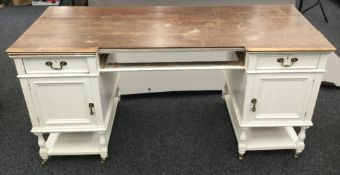 A Victorian white painted pedestal desk