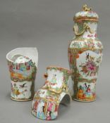 A pair of 19th century canton lidded vases. 28 cm high including lid.