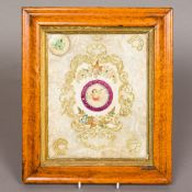 A 19th century silk and cut paper valentine panel Centred with cupid, housed in a burr maple frame.