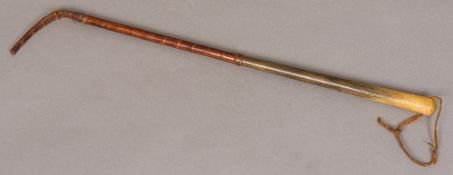 A late 19th/early 20th century crocodile skin mounted rhino horn riding crop Of typical form,