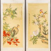 A pair of Chinese scroll paintings on silk Each worked with a bird amongst floral sprays,