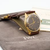 A 1960s IWC 18 ct gold grey dial gentleman's wristwatch With original guarantee and certificate of