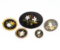 A collection of five pietra dura inset brooches The largest 9 cm wide.