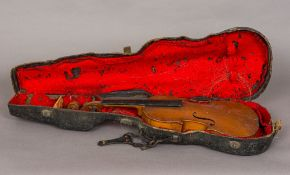A 19th century violin With single piece back, cased. 56.5 cm long.