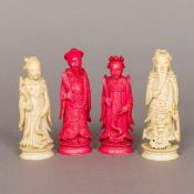Four 19th century Chinese carved ivory chess pieces Two red stained. The largest 10.5 cm high.