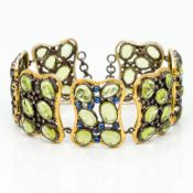A peridot and sapphire set unmarked gold and diamond bracelet 17.5 cm long.