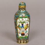 A fine quality Chinese cloisonne snuff bottle Decorated with opposing vignettes of flowering vases