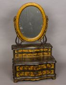 A late 18th/early 20th century chinoiserie lacquered dressing table mirror The oval plate supported
