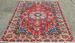 A red ground Hamadan carpet 222 x 144 cm.