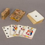A set of fifty-two Georgian playing cards Of typical form, each decorated with hidden erotic scene,