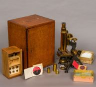 A W Watson & Sons lacquered brass monocular microscope Together with a quantity of various slides.
