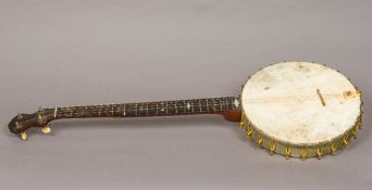 A late 19th century American banjo Of typical form, the reverse stamped for A C Fairbanks & Co,