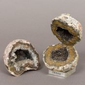 Two crystallised mineral geodes One mounted on a perspex display case. The largest 13 cm high.