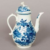A Worcester blue and white porcelain coffee pot Decorated in the round with birds and foliage in a