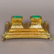A 19th century malachite inset gilt bronze desk stand The two lidded wells above the pen tray with