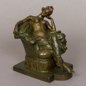 A patinated bronze figure Modelled as a young lady reclining semi-naked on an upholstered armchair.