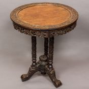 A 19th century Chinese carved tripod table The removable dished circular top carved with scrolling