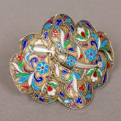 A Russian enamel decorated silver buckle Decorated with scrolling foliate design,
