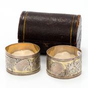 A pair of cased Victorian silver napkin rings, hallmarked London 1881,