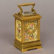A small lacquered brass cased painted porcelain set carriage clock The angular handle above the