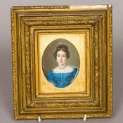 A 19th century miniature portrait on ivory Worked as a young lady with pearl earrings with a pearl