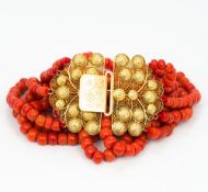 A six strand coral bead necklace Set with 18 ct gold filigree clasp. Approximately 38 cm long.