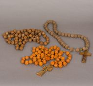 Three carved sets of rosary beads The longest 110 cm long.
