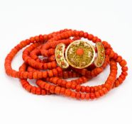 A five strand coral bead necklace Set with 18 ct gold filigree clasp. Approximately 40 cm long.