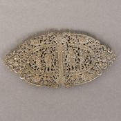 A 19th century Indian unmarked silver buckle Of two part pierced scrolling form,