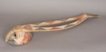 An African tribal carved wooden mask With pierced eyes and elongated headdress,