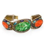 A Chinese enamel decorated silver filigree bracelet Set with jade and coral carvings. 17.5 cm long.