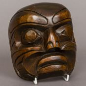 A North American Indian carved wooden mask 15.5 cm high.