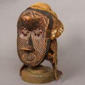 A carved wooden tribal Ba-kuba,