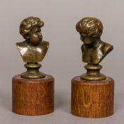 FERDINAND BARBEDIENNE (1810-1892) French A pair of miniature bronze busts each modelled as a