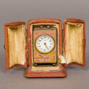 A Swiss enamel decorated silver cased miniature carriage clock The white enamelled dial with Arabic
