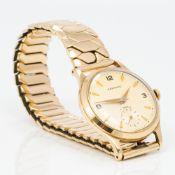 A Garrard gentleman's 9 ct gold wristwatch,