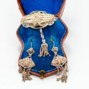 A cased set of Victorian silver filigree jewellery Comprising: a brooch with tassel drop and a pair