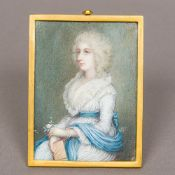 An 18th century portrait miniature on ivory Depicting an elegant lady in a white dress and blue