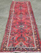 A red ground Hamadan runner 388 x 86 cm.