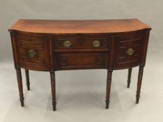 A Regency kingwood crossbanded ebony and satinwood line inlaid mahogany bow front sideboard The