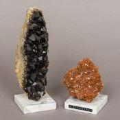 Two mineral specimens One aragonite, the other black quartz,