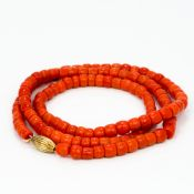 A single strand coral bead necklace Set with 18 ct gold clasp. Approximately 74 cm long.